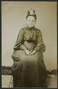 Elderly-Victoria-Lady-in-Black-Sits-With-Book-Clasped-in-Her-Lap-Early-RPPC