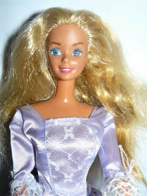 194db5f5af0d Mattel Twist N Turn Blond Barbie doll in light purple laced gown   shoes