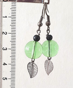 Black tone earrings with green glass crystal with black leaf charms beads