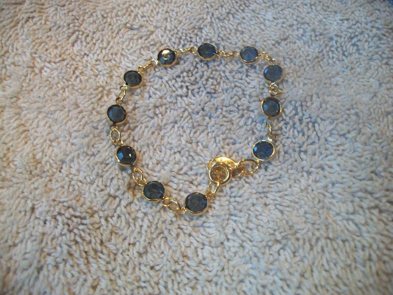 NOLAN MILLER Signed Tennis Bracelet Faux Sapphire Crystal goldtone Sz S Free Shp