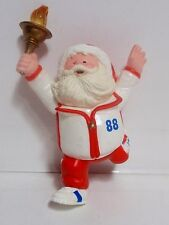 Go For The Gold hallmark ornament santa running with olympic tourch 1988 QX417-4