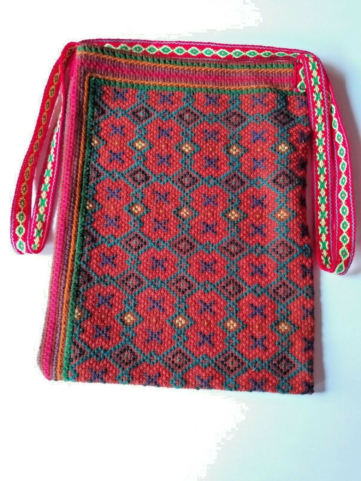 Peruvian hand-embroidered bag with Kené designs.