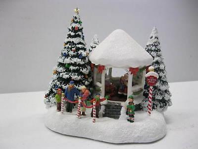 Teleflora's Thomas Kinkade's Jolly Santa Keepsake
