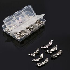 60-Stueck-Chaostuete-Fluegel-Perlen-Spacer-Engelsfluegel-Metall-Silber-Mix