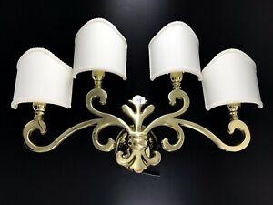 Applique lampada giglio fiorentino in ottone lucido con ventole a