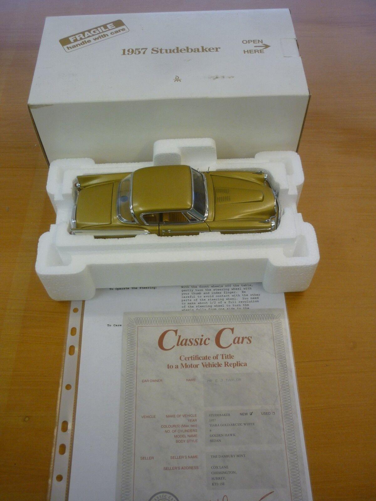 A Danbury mint scale model of a 1957 Studebaker golden hawk,  paperwork, boxed