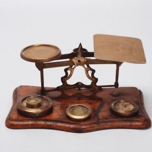 ANTIQUE BRITISH BRASS AND OAK POSTAL SCALE WITH WEIGHTS
