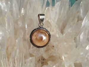 Tangerine-Aura-Quartz-Sphere-Pendant-Energizing-Orange-Zippy-Fun-Energy