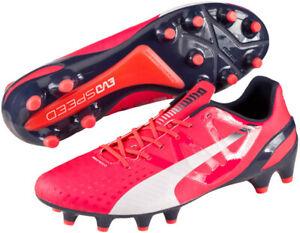 red puma football boots