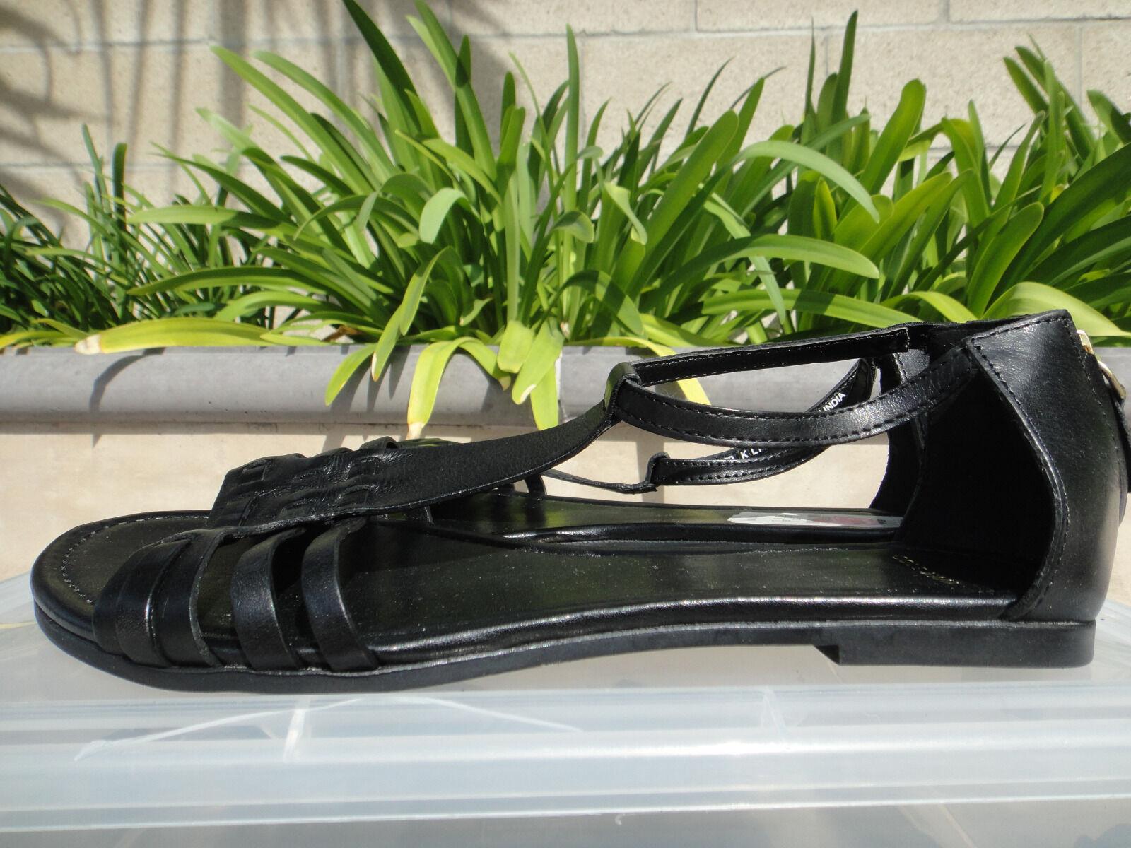Cole Haan Cady Sandalia, Negro Cuero Con Tiras Plano, Tamaño nos 7M, comprado en casi como nuevo