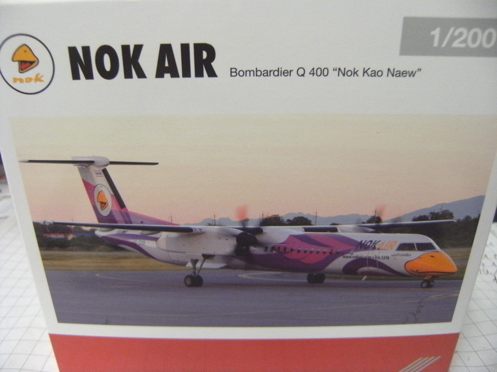 Herpa 1 200 558136  Nok Air Bombardier Q400  Nok Kao Neaw  NEU OVP