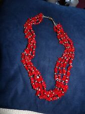 FOUR STRAND VINTAGE DYED RED CORAL CHIP NECKLACE WITH SILVER TONED SPACERS