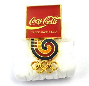 COCA-COLA-COKE-USA-con-risvolto-PIN-PULSANTE-STEMMA-SPILLA-Olympia-ANELLI-LOGO