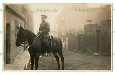 WW1 POSTCARD SOLDIER ON HORSEBACK HASTINGS BACK STREET SUSSEX REAL PHOTO 1914-18