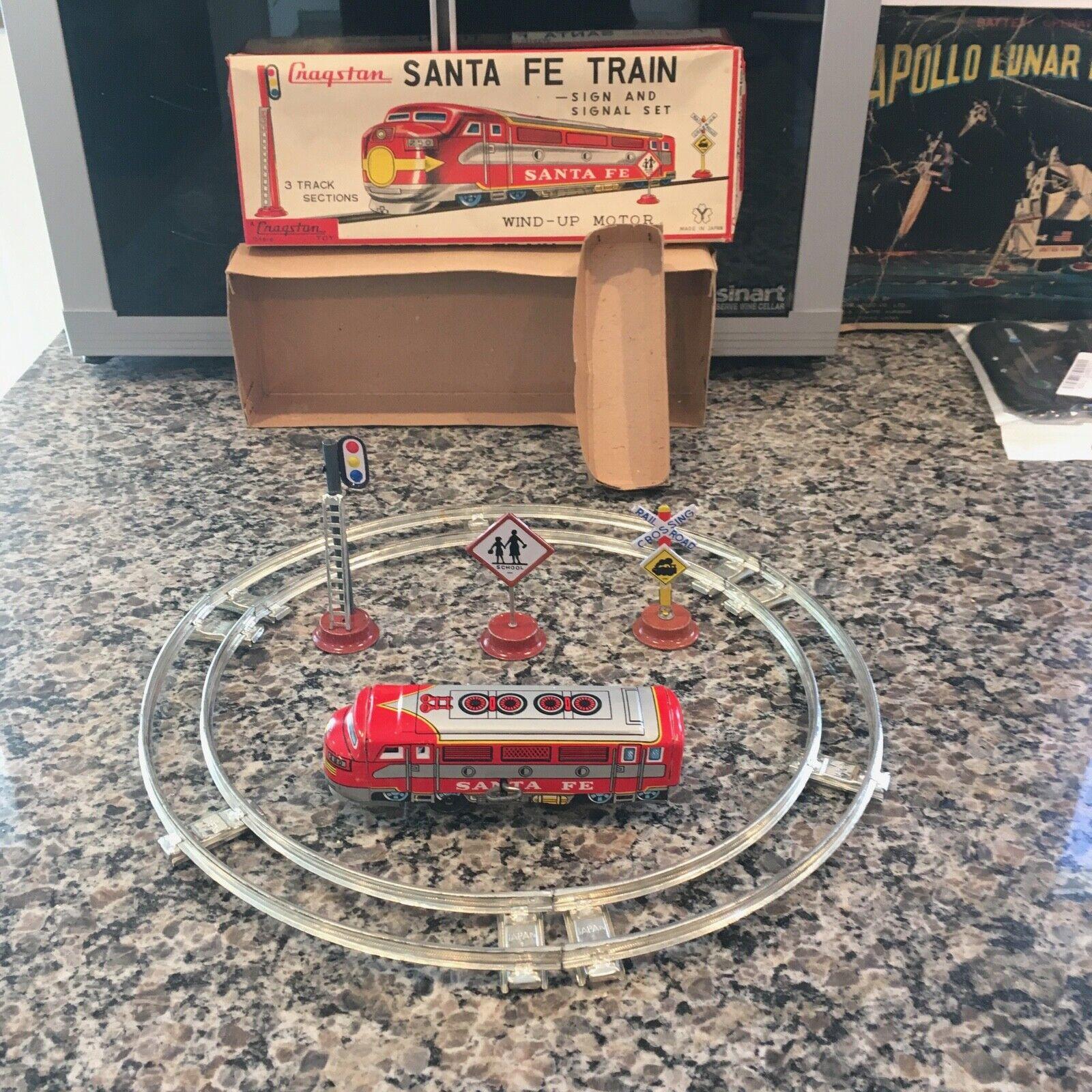 Vintage Yonezawa Estaño mecanismo de relojería tren distribuido por Cragstan Santa Fe Train Set.