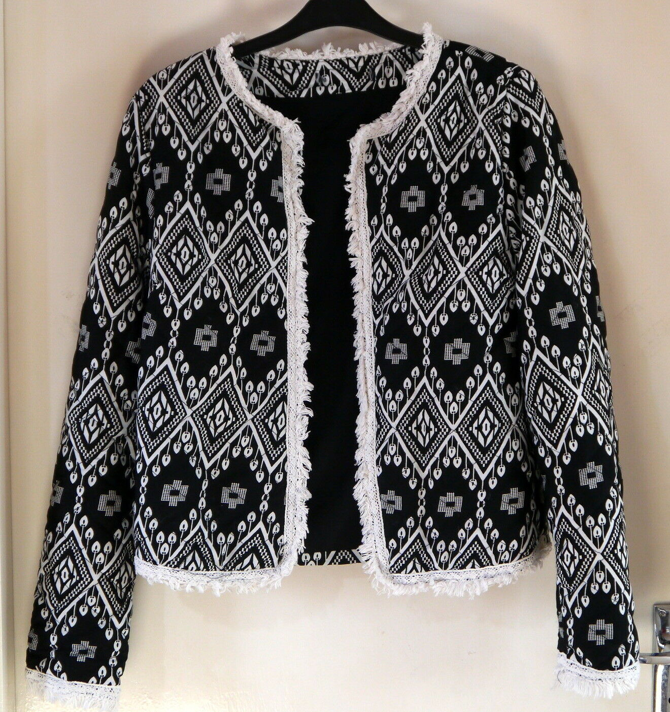 Atmosphere black quilted polyester jacket with white pattern size 10 length 21in