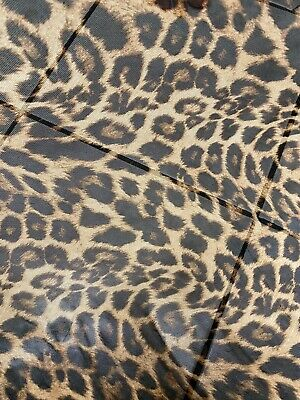 Ships worldwide from Los Angeles CA USA. New Hiding Exotic Leopard design print on pleated power mesh 4-way stretch 5860\u201d Sold by the YD