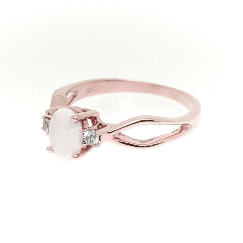 10K pink gold Ring swt with Oval Opal and two blueee Circon Companion Stones