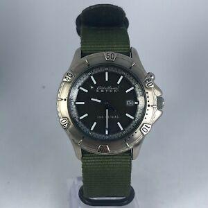 Eddie Bauer Mens EBTEK 0169 Light Up Date Quartz Analog Wristwatch Nylon Strap