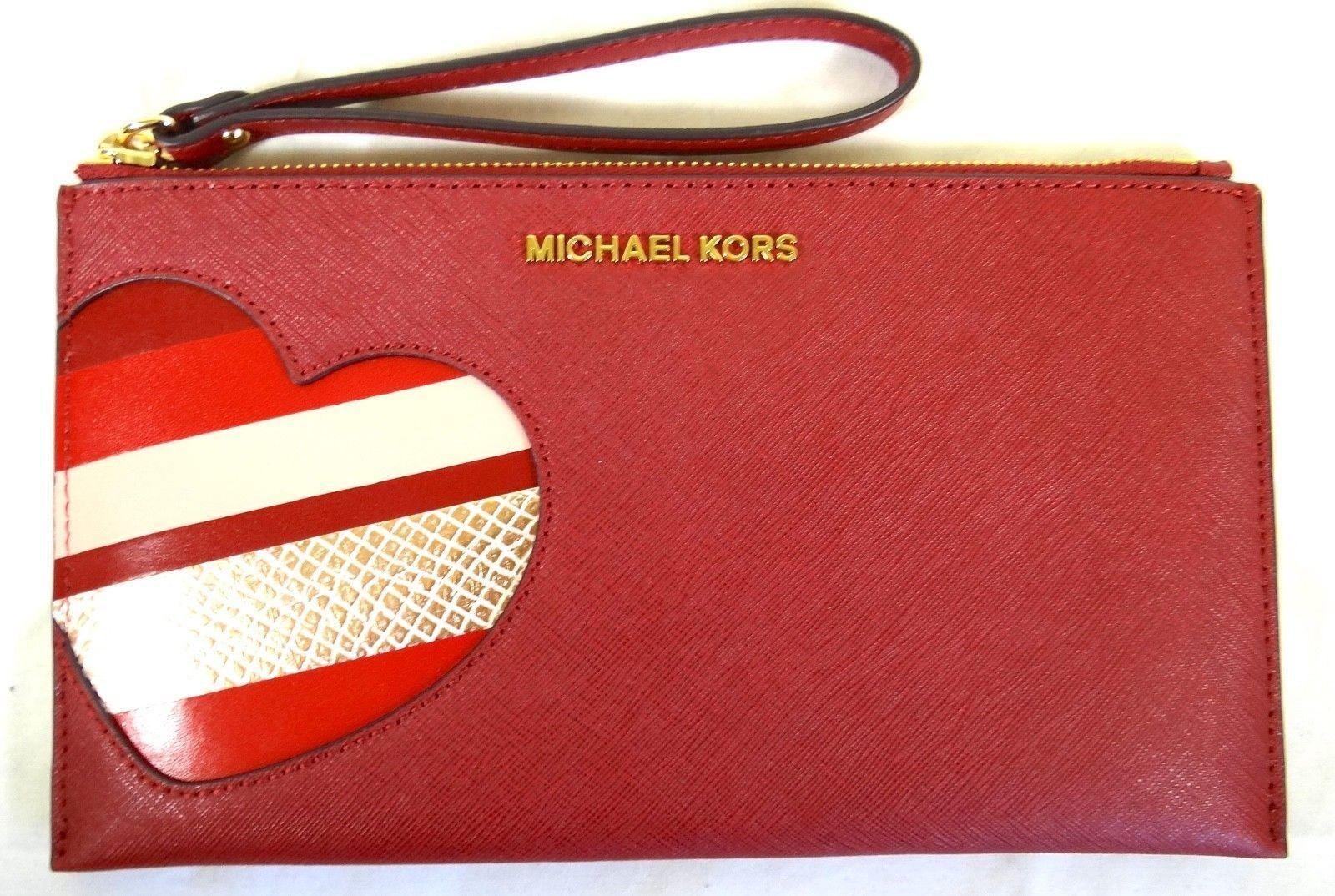 e8f51fb8179 Michael Kors Hearts JST Large Heart Zip Clutch Leather Handbag ...