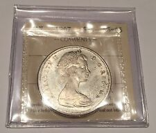GEM / 1967 Canadian Silver Dollar ICCS MS65, Nice Coin. Trends $450.00.