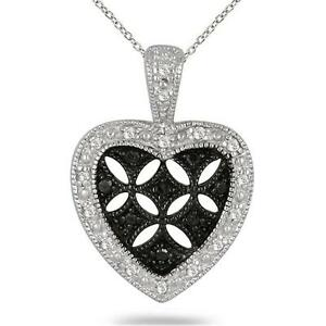 001bf3fd92a26 Details about 1/6 CARAT T.W BLACK AND WHITE DIAMOND HEART PENDANT IN .925  STERLING SILVER