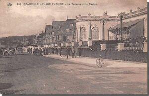 CPA-14-DEAUVILLE-PLAGE-FLEURIE-La-Terrasse-et-le-casino
