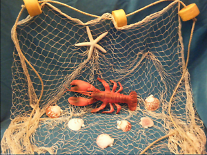 7/' X 7/' Nautical fish net with plastic lobster starfish shells rope and floats