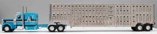 DCP FIRST GEAR 1//64 SCALE 389 PETERBILT FLAT TOP TEAL LIVESTOCK TRAILER #60-0813