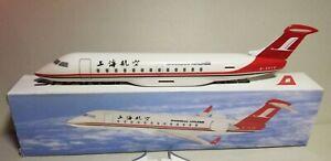 FLIGHT-MINATURE-SHANGHAI-AIRLINES-CRJ-200-1-100-SCALE-PLASTIC-SNAPFIT-MODEL