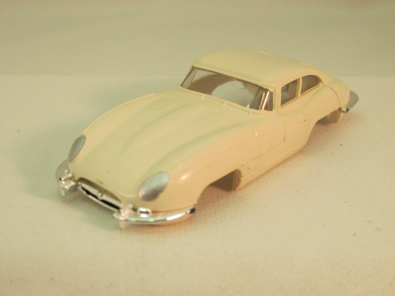 AURORA MODEL MOTORING WHITE XKE JAGUAR SHELL  UNCUT WHEELS  MINT COND