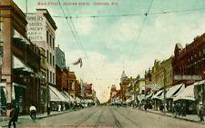 Oshkosh, WI Shops and Flags along Main Street looking North 1908