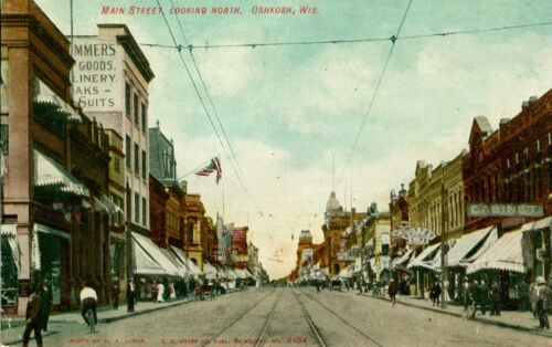 Oshkosh, WI Shops and Flags along Main Street looking North 1908