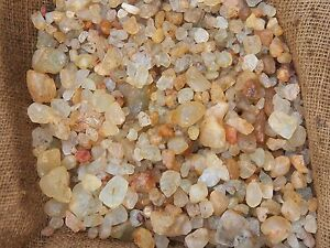 1000-Carat-Lots-of-Unsearched-Topaz-Rough-Plus-a-FREE-Faceted-Gemstone
