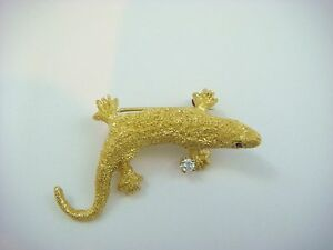 ! GORGEOUS 18K GOLD LIZARD BROOCH WITH DIAMONDS AND RUBIES, 7.2 GR, 34.5 MM.