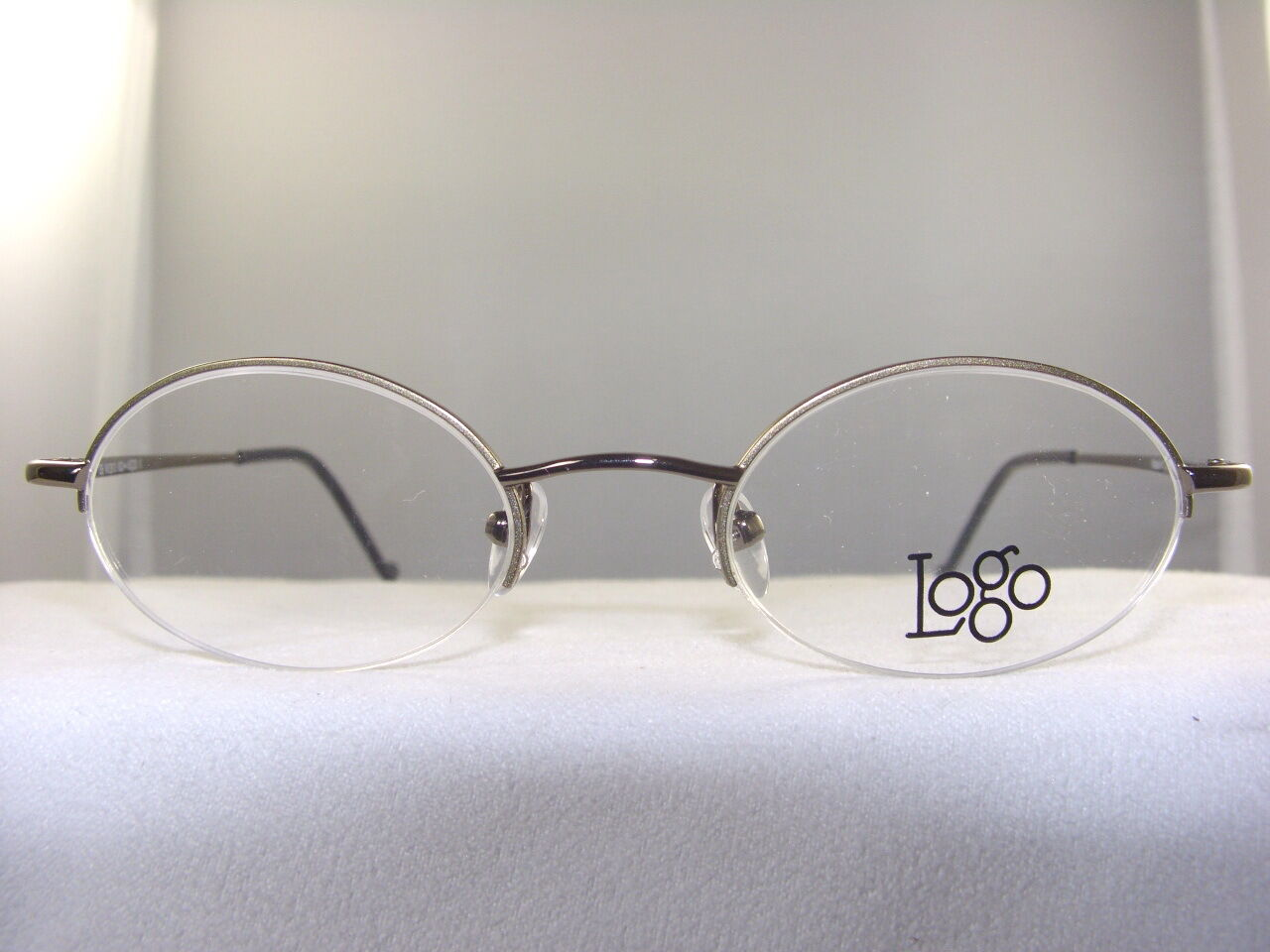 SMALL SEMI RIMLESS EYEGLASS FRAME IN BROWN SIZE 45-20