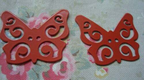 In the shape of a Butterfly with a pierced design 2 Large Rust Metal Buttons