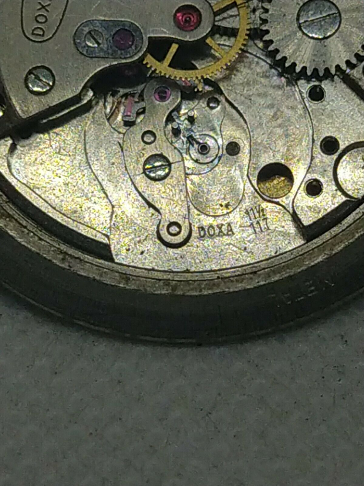 Image 12 - Doxa Cal 117 - 11 1/2  Movement for parts or repair Ultra Rare wind up Vintage