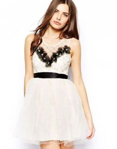 Image is loading Lipsy-VIP-Cream-Skater-Dress-with-Floral-Applique- 66f924138