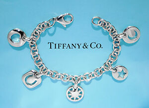 3c8b868f2bdf4 Details about Tiffany & Co Sterling Silver Pierced Stencil Star Moon Heart  5 Charm Bracelet