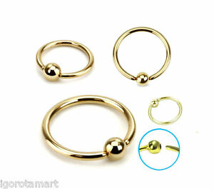 2 large oval gold steel bead rings