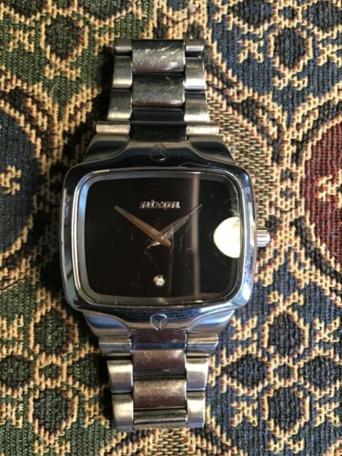 Mens Nixon The Player stainless steel watch black dial with a diamond