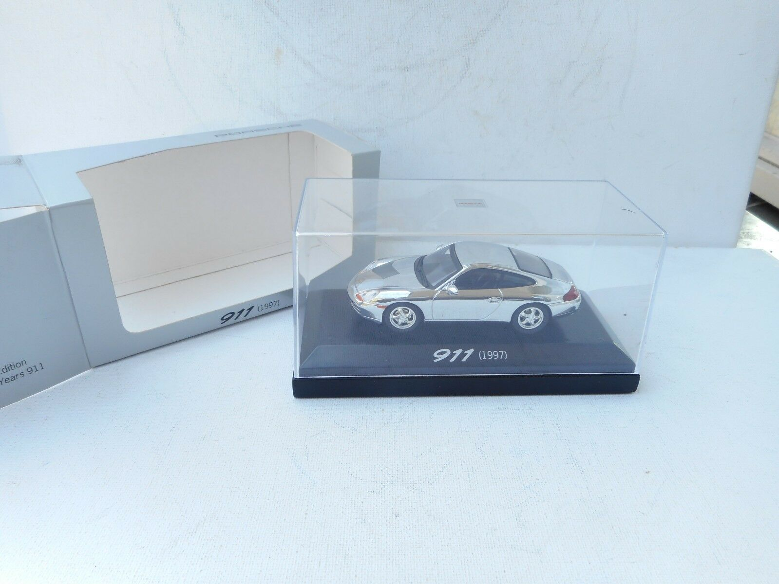Rare Porsche Dealer 911 Coupe from 1997  in Chrome. Minichamps 1 43 Diecast NEW