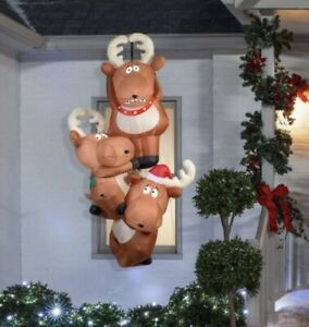 Gemmy Airblown Inflatable Reindeer Hanging From Rooftop