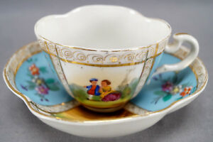 Dresden Hand Painted Courting Couple Floral Blue & Gold Quatrefoil Cup & Saucer