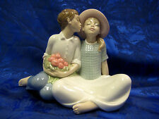 STEALING A KISS BOY AND GIRL COUPLE SITTING BENCH FIGURINE NAO BY LLADRO  #1781