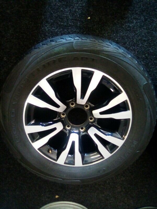 """18"""" Isuzu X-Rider original mag with used tyre to use for spare wheel R2500."""