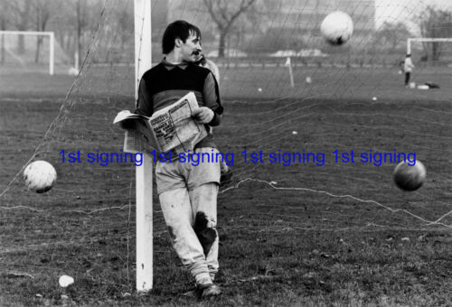 Brian Thornton Derby County reads paper during training 12x8 unsigned photo