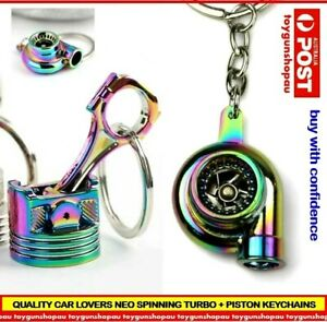 2-X-NEO-TURBO-KEYCHAIN-PISTON-RAINBOW-METAL-TURBOCHARGER-SPINNING-TURBO
