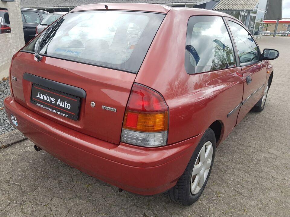 Mazda 323 1,5 LX Benzin modelår 1997 km 144000
